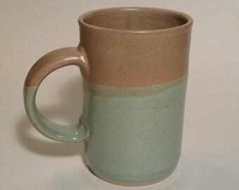 handmade stoneware green tan mug / holds 10 ounces