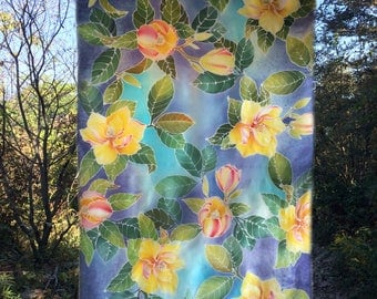 An elegant yellow, blue, and purple magnolia,  Hand painted on 100% silk, Batik technique with hot wax, one-of-a-kind work of art.