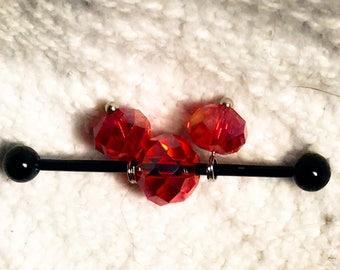Sparkling faceted red glass crystal beads on 14g silver or black anodized stainless steel industrial barbell body jewelry