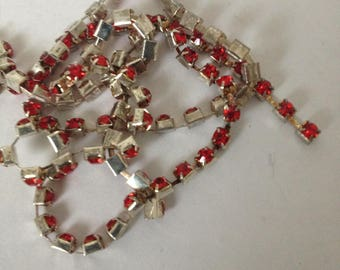 Mini red rhinestones mounted in silver plated chain