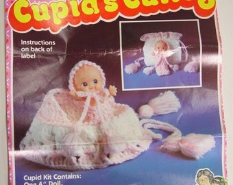 Vintage 1982 NOS Never Used Cupid's Cuties Crochet Cradle Purse Doll Kit by Distlefink Designs.