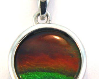 Round Shape Ammolite Pendant set in Sterling Silver.