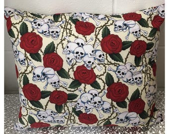 Decorative skull and roses cushion