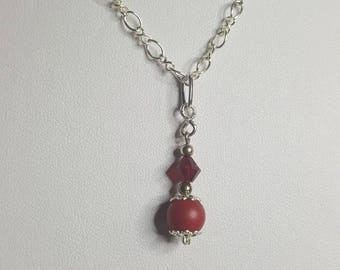a beautiful red pendant with Swarovski element and silver necklace