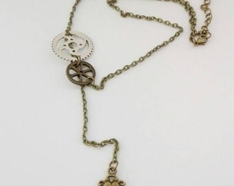 Necklace with mechanical and key gears