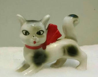 Collection of vintage miniature cat figurines and salt & pepper shakers