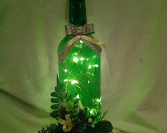 Hand decorated green wine bottle with pine cones & LED fairy lights