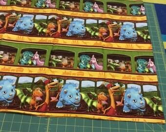 Dinosaur Train fabric.  BTY