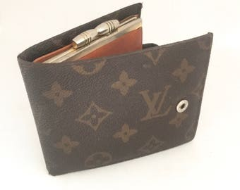Worn Vuitton wallet and card holder