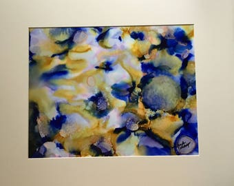 Abstract alcohol ink painting in vibrant colors, yellow and blue