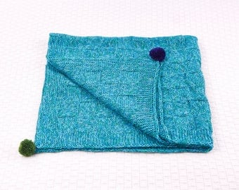 Cosy hand-knitted baby blanket