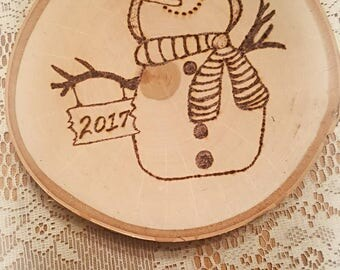 Hand-made wood burned snowman on birch wood