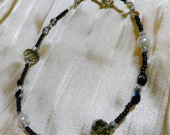 Beaded anklet with black and tan beads