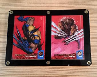 1994 Fleer Ultra X-men Super Heroes Wolverine and Sabretooth Encased in Display Never Opened! Cards are in Mint Condition.