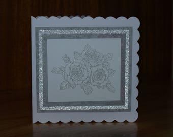 Handmade silver rose motif greetings card