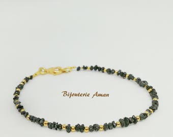 Bracelet made of rough diamonds and gilded elements