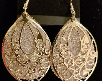 Gold colored earrings.