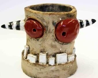 Stoneware glazed monster pot