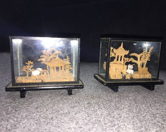Two miniature artworks made with cork from Japan