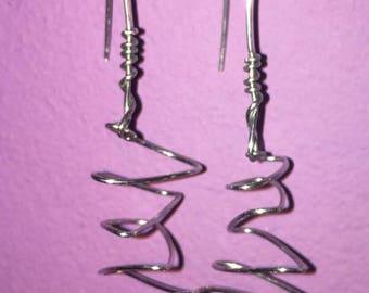Asymmetric spiral dangle earrings