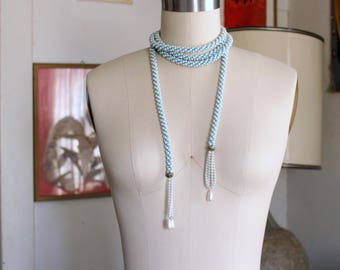 "plastic vintage flapper style sautoir rope necklace . pearl look crocheted on aqua turquoise thread, tassel lariat necklace - 82"" long"