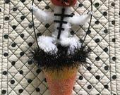 pumpkin head skeleton chenille candy corn cone ornament