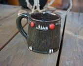 MothMan stoneware mug