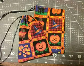 Halloween drawstring pouches or treat bags.