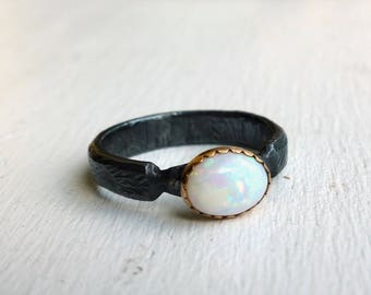 Snow White Opal Ring in 14k Gold Bezel on a textured black band