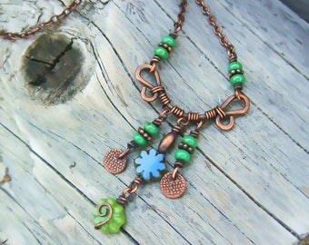 Czech Picasso glass flower beads wire wrapped in antiqued copper summer dangle necklace