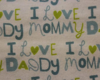 """I love Mommy  I love Daddy Green Blue on white 100% cotton flannel  41""""-44"""" wide"""