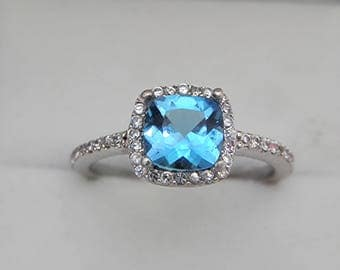 AAAA London Blue Topaz 7x7mm Cushion 1.45 Carats   in 14K white gold Halo ring with .30 carats of diamonds 1860
