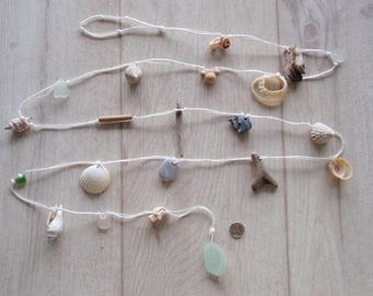 "English seaglass garland,holed shells, beads, pebbles,driftwood ,sea glass seafoam finish 72""long"