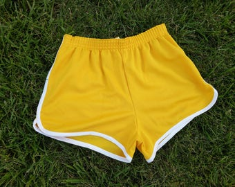 Vintage Large Broderick USA 80s golden yellow and white trim gym shorts