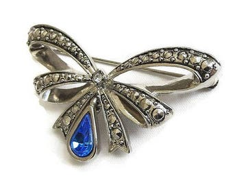 SALE Faux Marcasites Bow Brooch with Dangle Blue Rhinestone Vintage by AVON