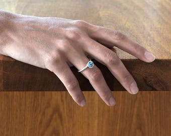 Engagement ring, sterling silver, gem stone, icy-blue topaz, December, symbol, fidelity, love, patient attitude, romantic, handmade, Israel.
