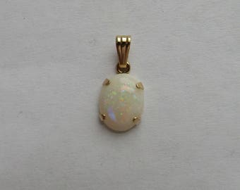 Sweet Precious Opal Pendant in 14K yellow gold, 9x7mm oval solid opal with red and green play of color, free US first class shipping
