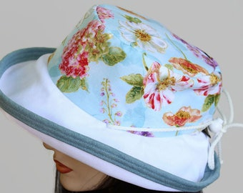 Sunblocker UV summer sun hat with large wide brim featuring pastels blue floral print and adjustable fit