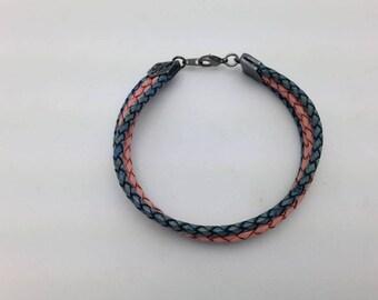 Denim & Dusty Leather Bracelet. Denim Blue and Dusty Pink Braided Leather 3mm Cording make this bracelet w/ Tierra Cast Gunmetal Crimp Caps