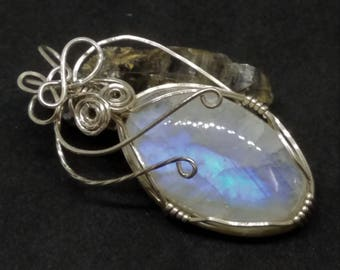 Rainbow Moonstone Pendant wire wrapped in Sterling Silver wire.