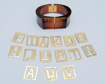 Unique Vintage Clamp Bracelet . Some Letters . Hard Plastic . Metal Gold Brass Letters