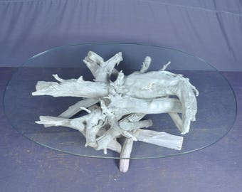 Sun bleached oval driftwood coffee table