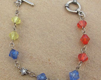 Charm bracelet red, yellow and blue with stars