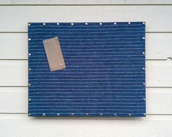 Upholstered Pin Board in striped Navy and silver Linen, solid wood frame with upholstery silver nail head trip, mansculine office board