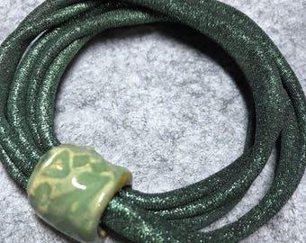 Green Lycra Stretch Bracelet with Handmade Ceramic Bead