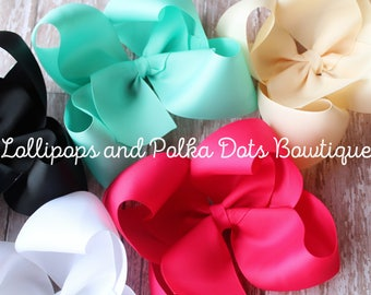 """Set of 9 6"""" solid twisted boutique bows"""