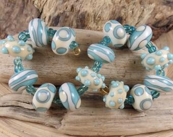 Lampwork BeadSet: 14 handmade glass beads, light turquoise & ivory