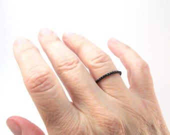 Stackable thin black seed bead ring, Minimalist ring for men or women, pinky thumb or knuckle ring