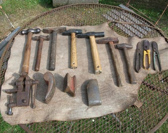 Large lot of 7 Armourer's hammers and one bench vise, Planishing, Dollies, tin snips