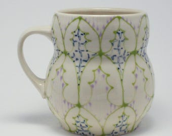 Handmade Wheel Thrown Ceramic Mug with Kiwi, Navy and Faded Pink Pattern